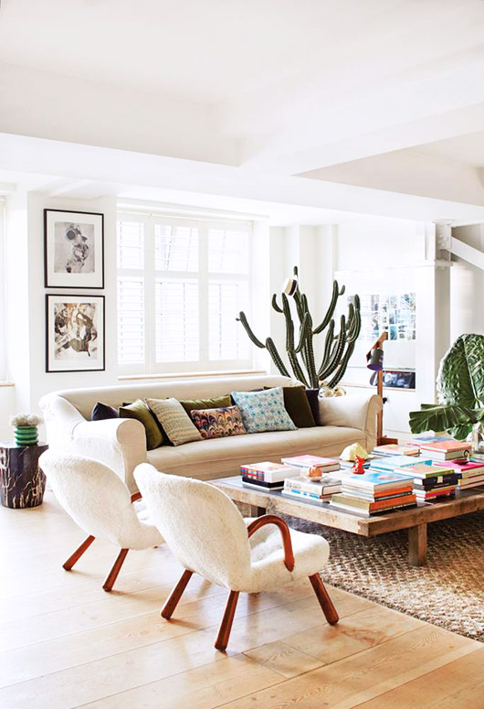 living room with large coffee table filled with books. / sfgirlbybay