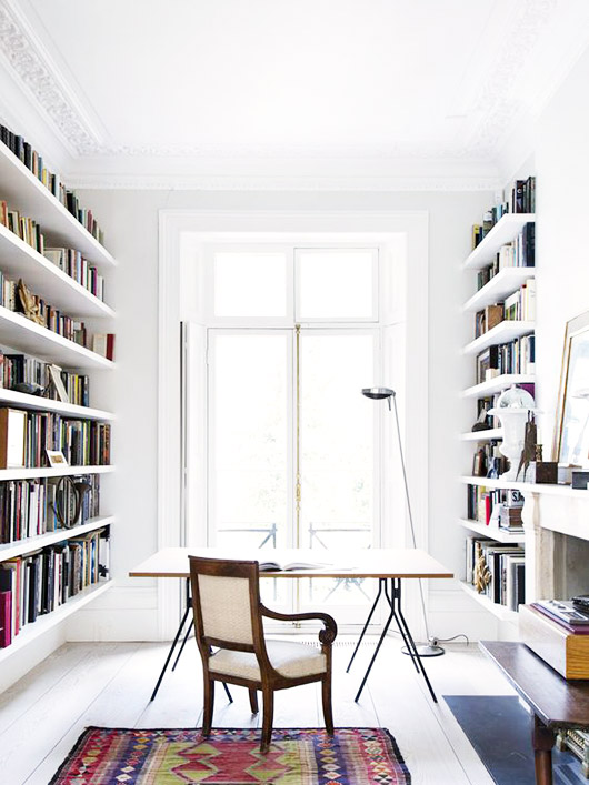white home library with desk and chair and floor lamp. / sfgirlbybay