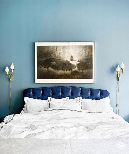 blue tufted headboard and pale blue wall paint. / sfgirlbybay