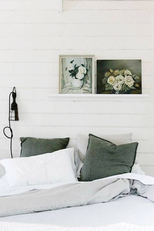 green gray bedding with shiplap walls and floral paintings. / sfgirlbybay