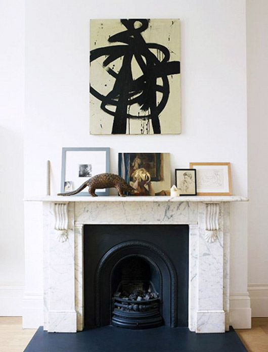 art and decor on marble mantle. / sfgirlbybay