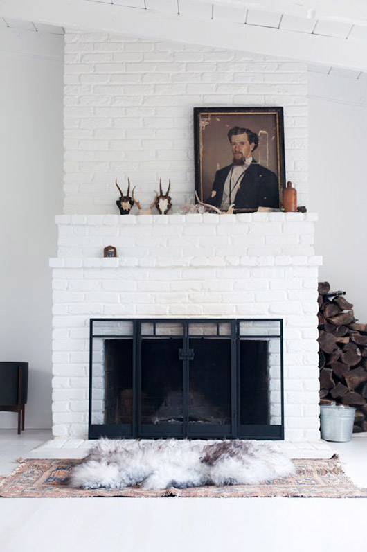 vintage portrait painting on white brick two-tier mantle. / sfgirlbybay