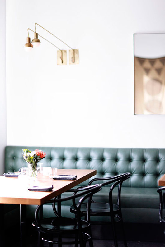 green booth and black bentwood chairs in ostrich farm dining area. / sfgirlbybay