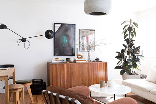 credenza with art objects on it and art above. / sfgirlbybay