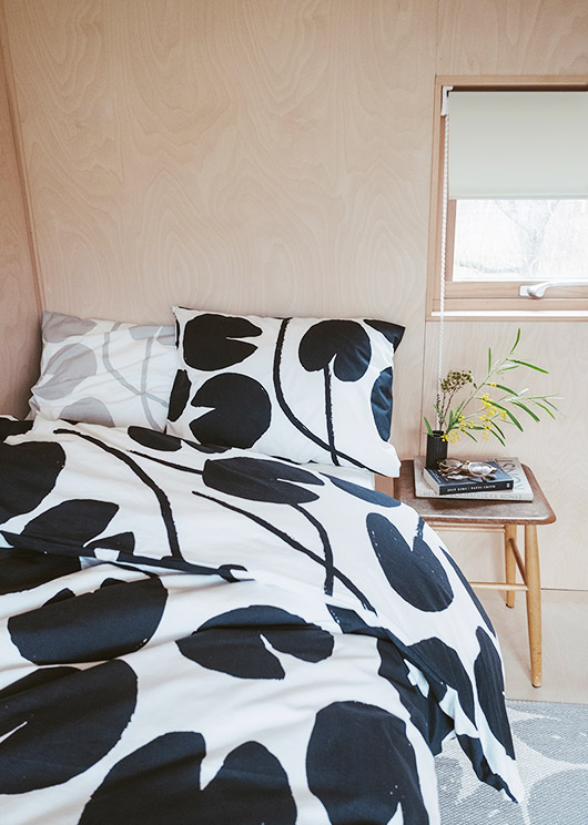 plywood walls and black and white floral duvet via fine little day. / sfgirlbybay