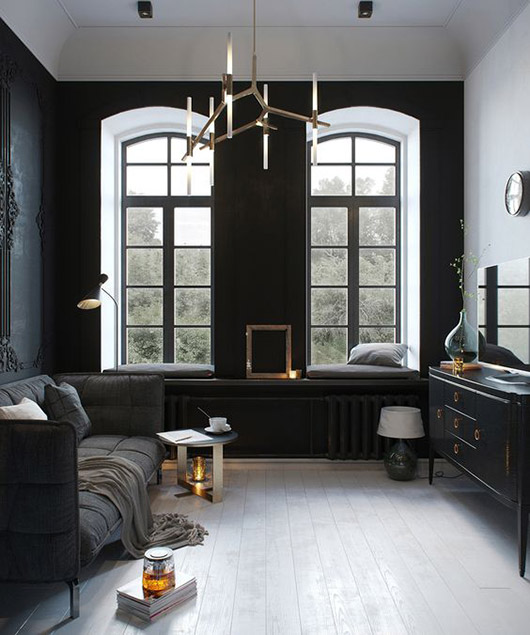 black walls with ornate moldings. / sfgirlbybay