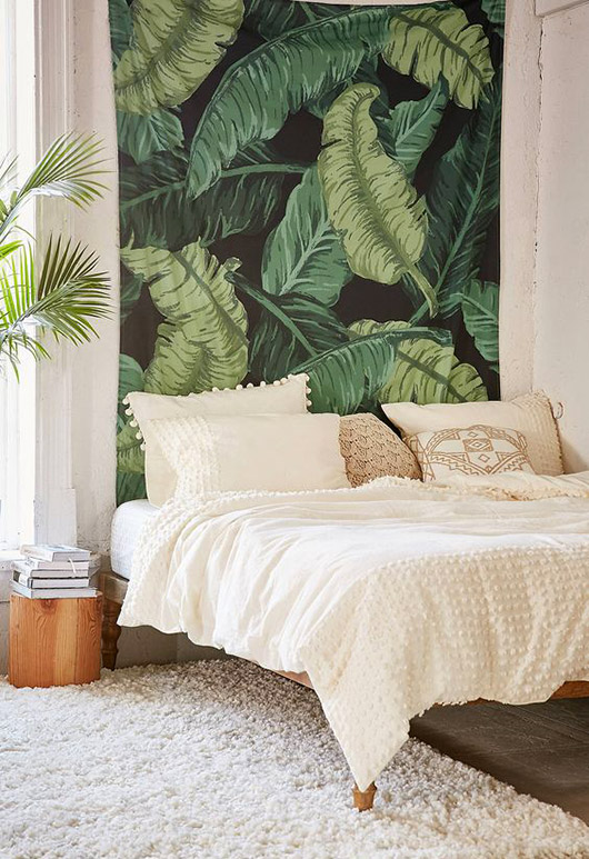 palm leaf print fabric hung over bed. / sfgirlbybay