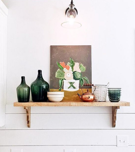green glass jugs and still life painting on shelf. / sfgirlbybay