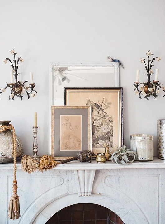 vintage sconces and marble mantle. / sfgirlbybay