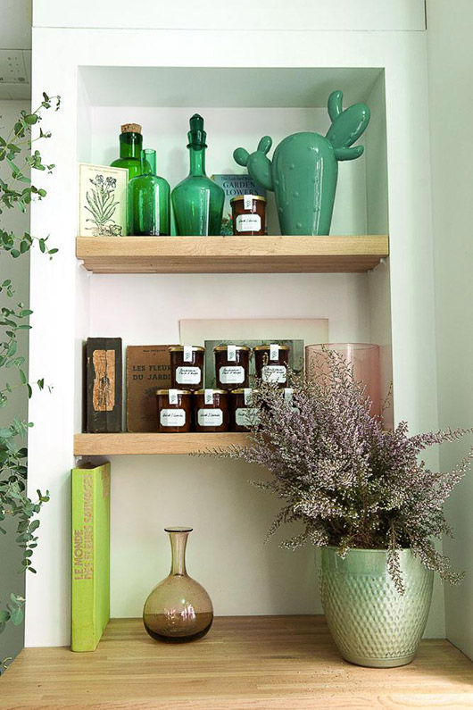 green vases and jars on wood shelves. / sfgirlbybay