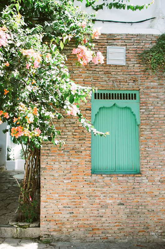 brick building with green shutters. / sfgirlbybay