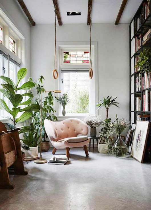 modern pale pink chair in loft like plant-filled space. / sfgirlbybay