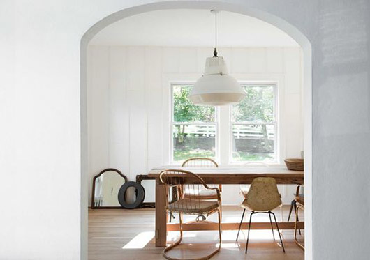 white washed dining area with vintage furnishings. / sfgirlbybay