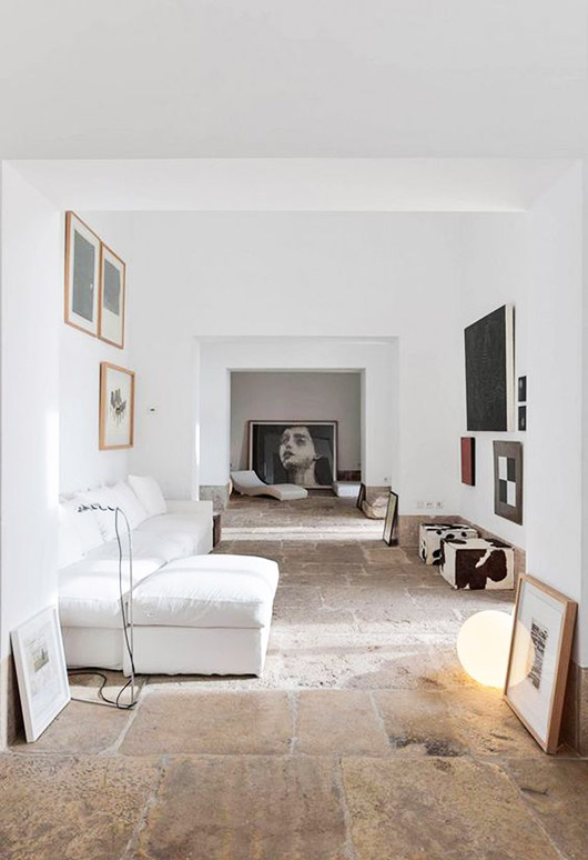 white walls with white sofa and art. / sfgirlbybay