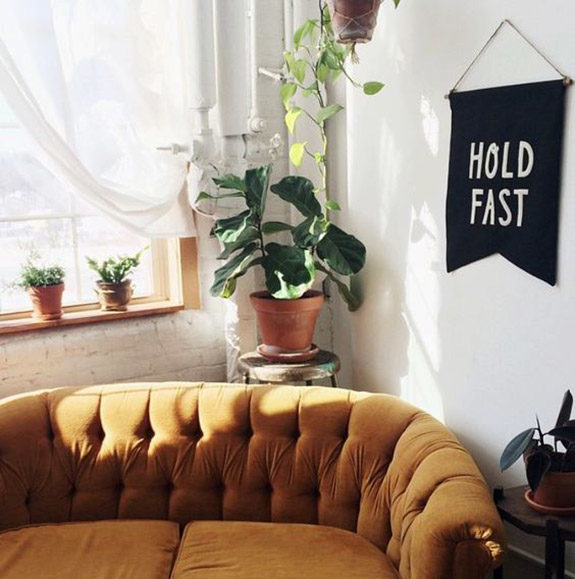 gold hued tufted loveseat. / sfgirlbybay