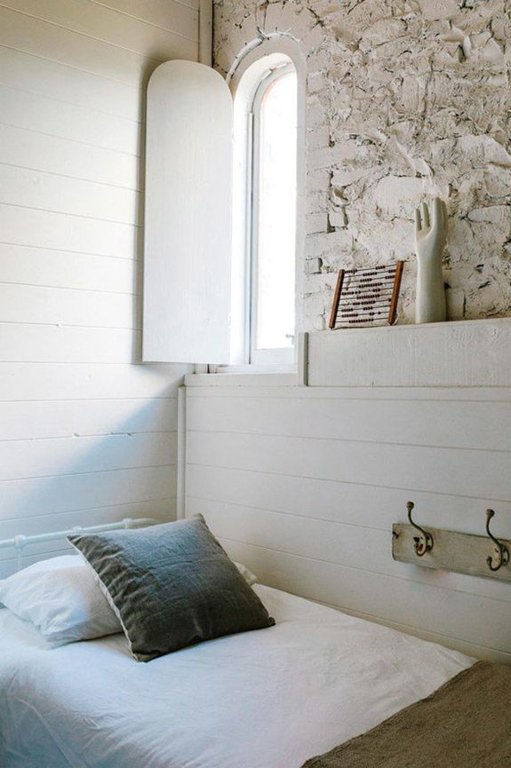 rustic guest bedroom with vintage art objects. / sfgirlbybay