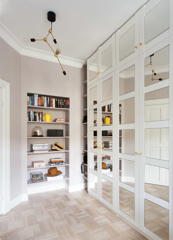 mirrored cabinets and built-in bookshelves in oslo apartment via rue magazine. / sfgirlbybay