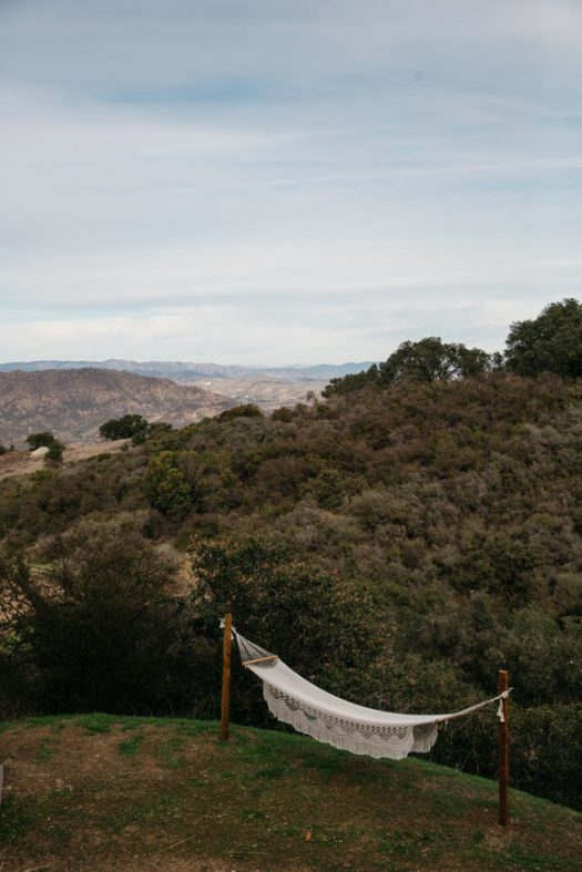 bohemian hammock on green hillside in malibu. / sfgirlbybay