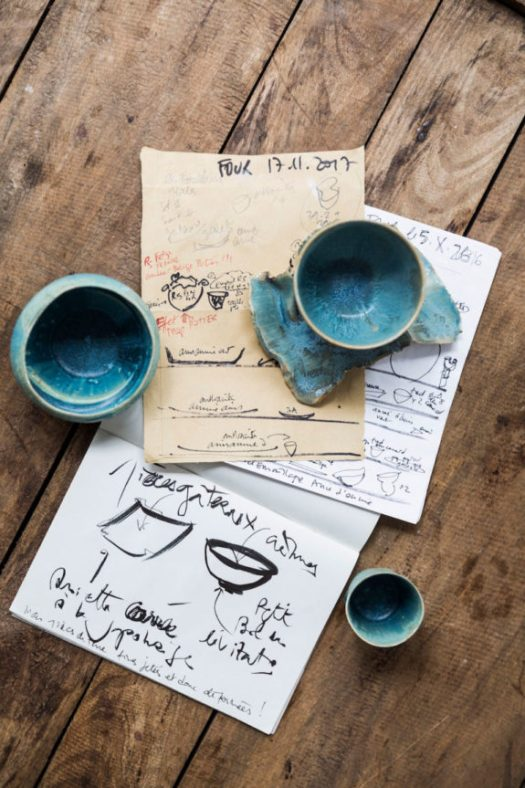 blue ceramics and sketches by artist Ema Pradère's inside her paris workshop. / sfgirlbybay