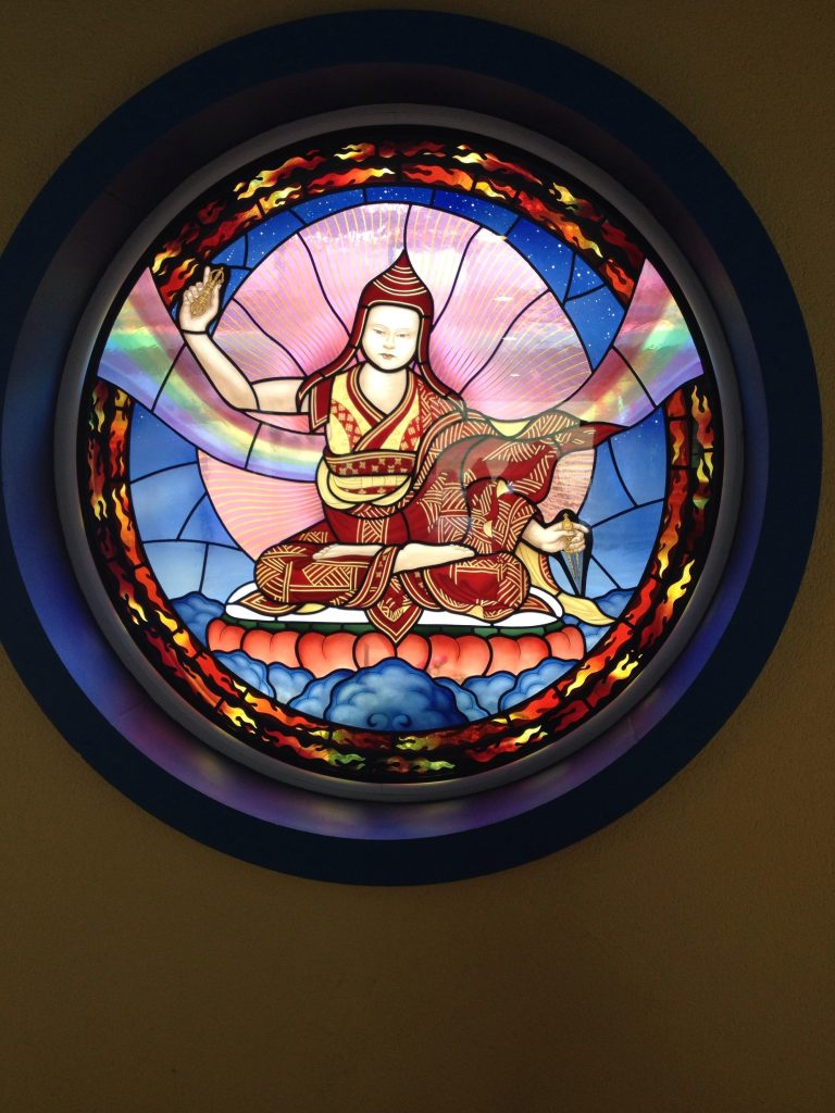 Stained glass window on the approach to the temple courtyard