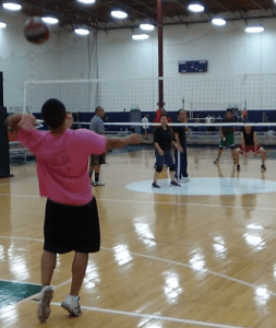 Wernnie serving a volleyball to the opposing team.