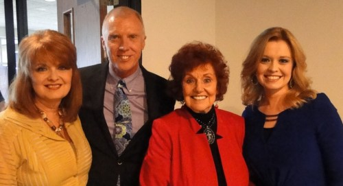 Photo A. The Talleys--Debra, Roger, Lauren, with Lou Hildreth