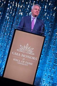 Ed Leonard introducing Karen Peck Gooch at the GMA Hall of Fame honors. (Chip Woods Photography)