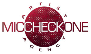 The Kendricks sign with Mic Check One