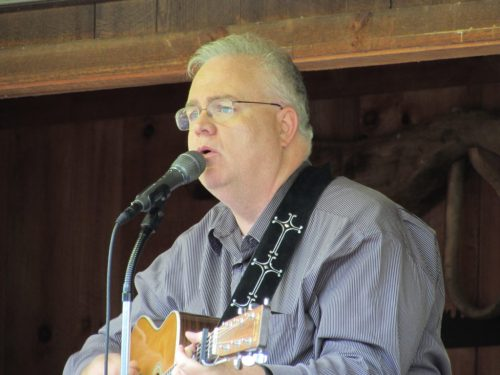 Les Butler playing and singing at Hominy Valley