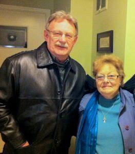 Jim Brady blesses a mourning husband