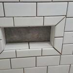 Farmhouse inspired-Barn wood tile shower niche Low shaving legs foot rest