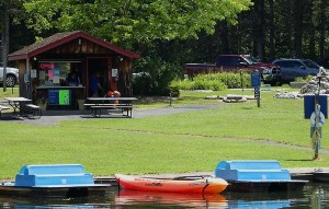 Paddle boats and kayaks in the foreground with mini golf behind