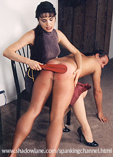 sitting with spanking paddle