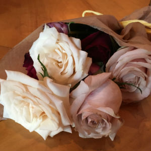 paperwrapped_bouquet_of_white_pink_red_roses