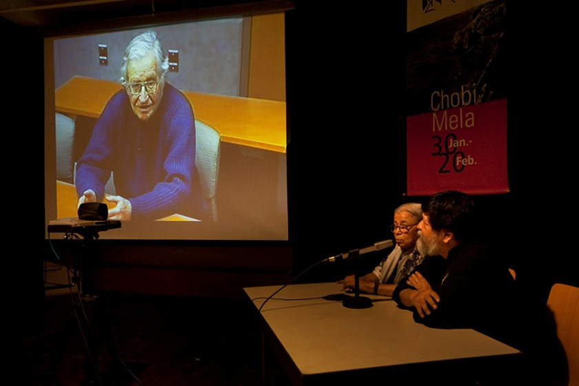 Noam Chomsky (on screen) and Mahasweta Devi, India's leading activist and writer in video conference moderated by Shahidul Alam during Chobi Mela. Photo: Drik