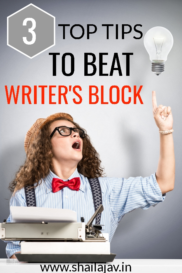 Woman pointing to bulb indicating idea to beat writer's block