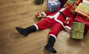 Santa Lying Under Presents