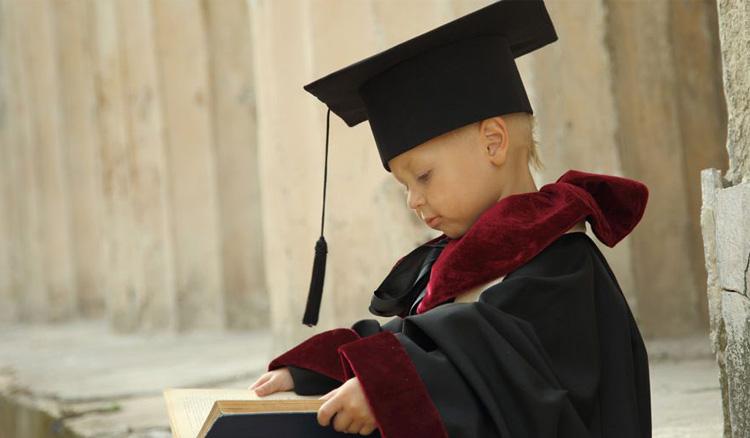 Child dressed like a college graduate