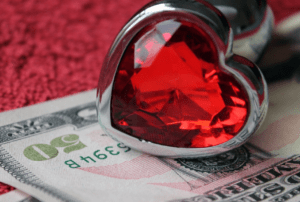a heart ring and money