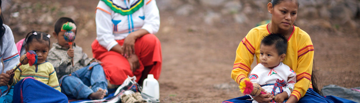 Huichol Women and Children performing a traditional shamanic ceremony
