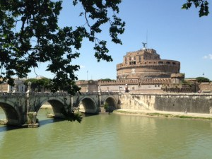 The Tiber flows past the Castel San Angelo and its bridge. Built as Hadrian's tomb, it used to be covered in marble.