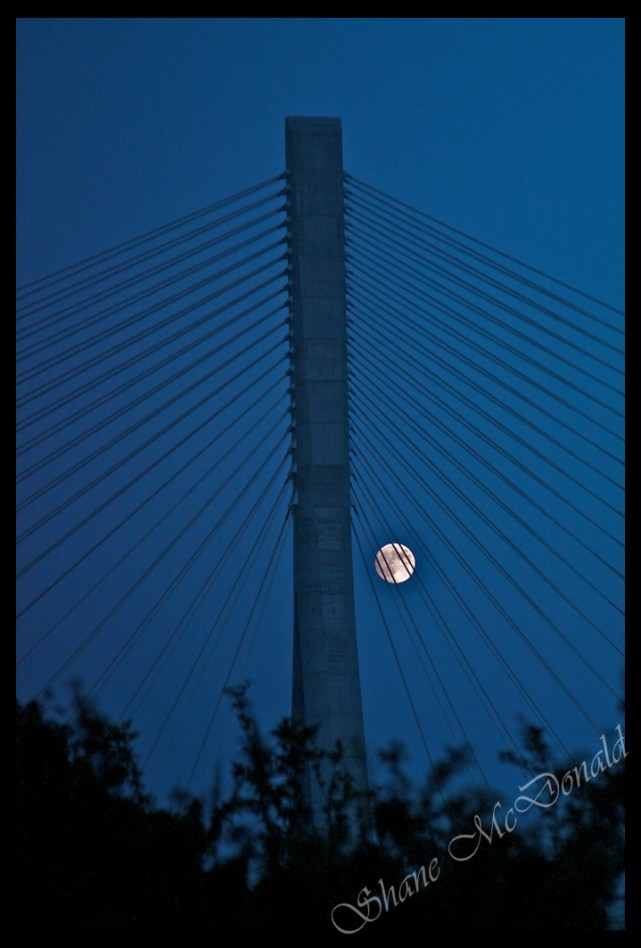 Waterford N25 Suspension Bridget with the Moon shot through the Suspension Cables of the Toll Bridge