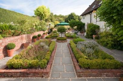Garden design showing an asthetically pleasing herb garden.