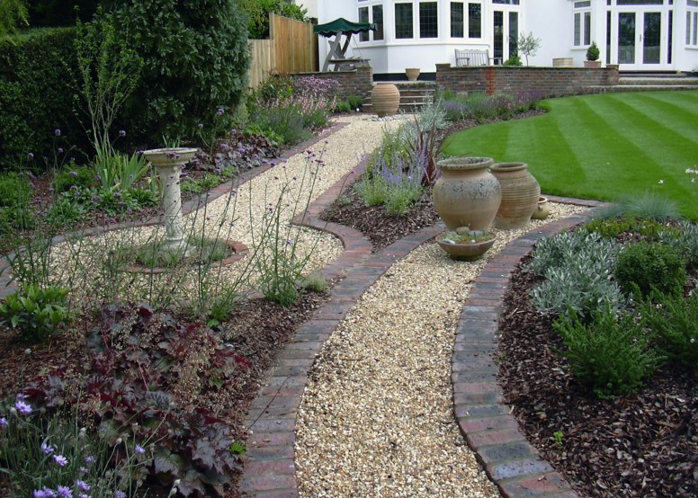 Simple brick edged paths gave a purpose to the garden in this medium sized garden.