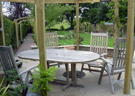 Medium sized garden - A place to relax and dine while listening to the water run down the rill.