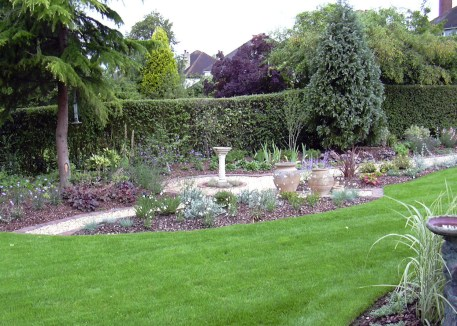 Interesting planting give colour and fragrance in this medium sized garden.