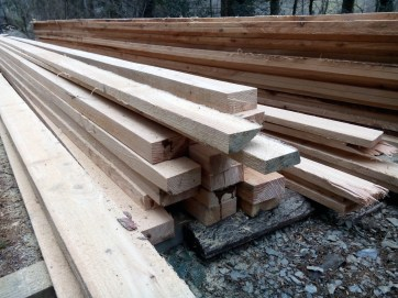 Cut timber planks in a pile, douglas fir and larch. Used to build the wooden structures for the RHS Flower Show Cardiff 2015 show garden.