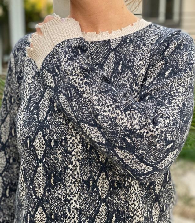 Distressed animal print sweater