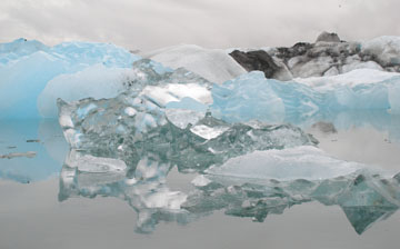 We've circled around to the southern side of the island and reached the Iceberg Lake. The blue color of the ice is caused by the refraction of light as it penetrates deep into the highly-compressed ice. No matter how deeply you dig, the ice will still be clear.