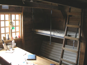 "This is the interior of the hut, or at least as much as I could fit into a camera frame with my back against the opposite wall. The guest book on the table had an entry from a Canadian hiker who wrote, ""Time spent in the mountains is never deducted from the rest of your life."""